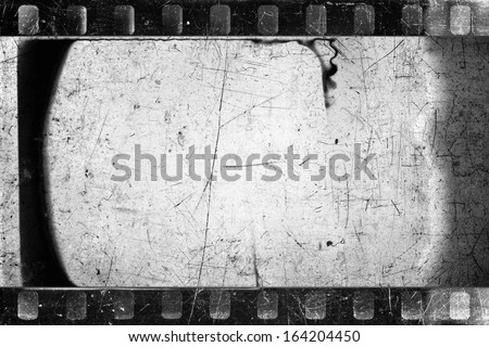 Old scratched and damaged grungy negative filmstrip - stock photo