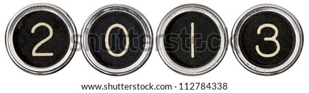 Old, scratched chrome typewriter keys with black centers and white letters spelling out 2013.  Each key is isolated on white with clipping path. - stock photo