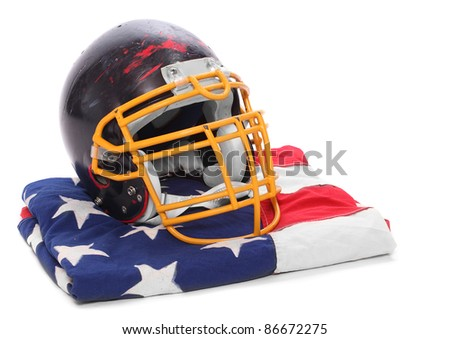 Old scratched football helmet on a american flag. - stock photo