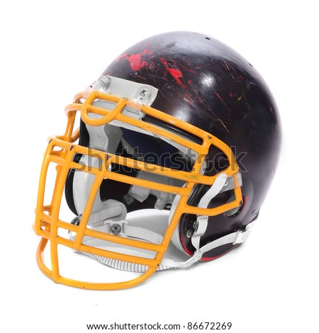 Old scratched football helmet on a white background.