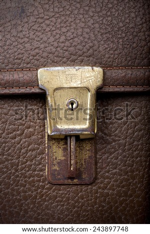 old scratchy lock of used leather shool bag, closeup - stock photo