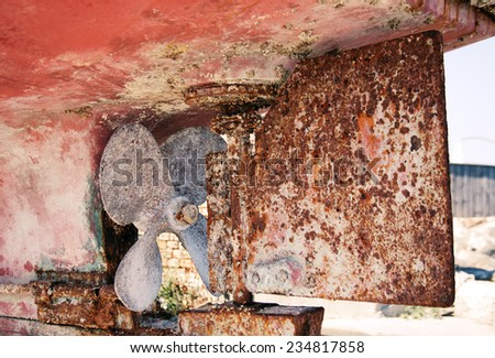 Old screw propeller in the rustic ship on the coast - stock photo