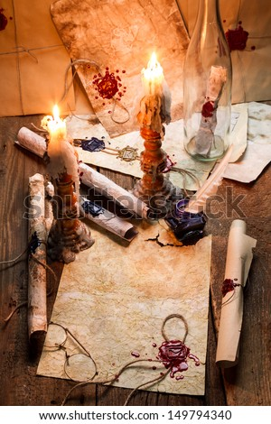 Old scrolls and candles are the old scribe's workplace - stock photo