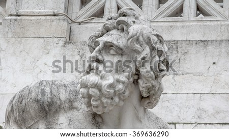 Old sculpture of zeus beside National Monument to Victor Emmanuel II in Rome - stock photo