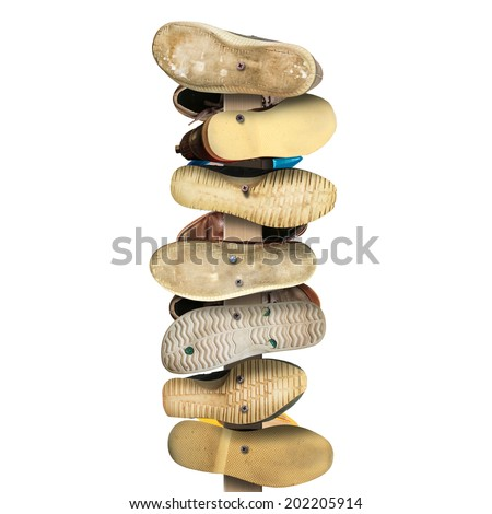 Old secondhand shoes nailed to a Board, a sign - stock photo