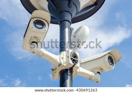 Old Security CCTV camera on floor lamp for decorate park in blue sky