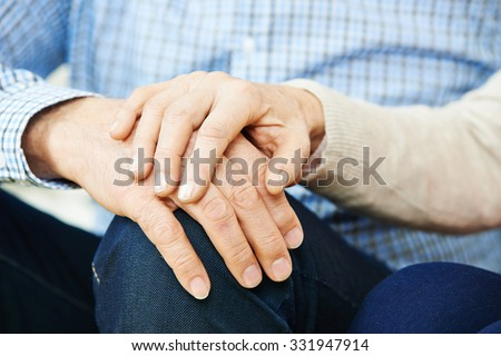 Old senior couple in love holding hands - stock photo