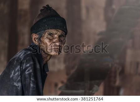 Old senior man closeup serious expression portrait, thinking to his son, unhappy man - stock photo