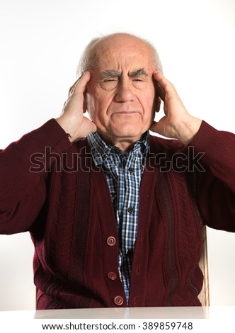 old senior man having problems, thinking, beeing serious, having headache