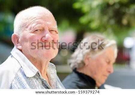 Old senior man serious expression - stock photo