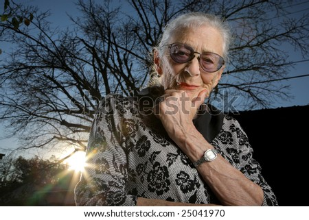 Old senior woman thinking - stock photo