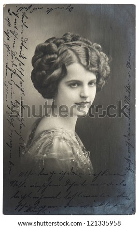 old sepia photo of young woman with signature. vintage picture from 1914 - stock photo