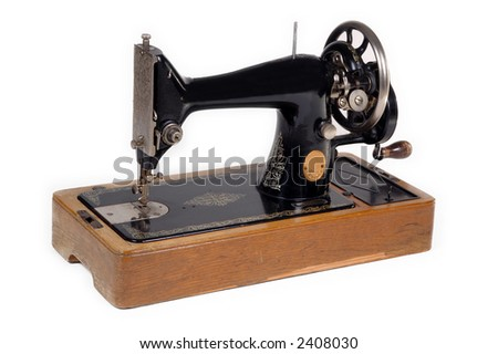 Old sewing machine. Taken on white background.