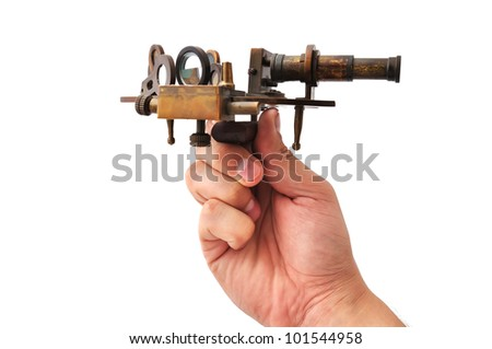 old sextant in hand  on a white background - stock photo