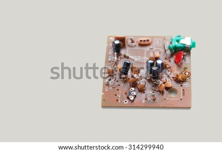 Old, shabby microchip macro view. electronic circuitry in a vintage radio. Soft focus. Copy space. gray background. - stock photo