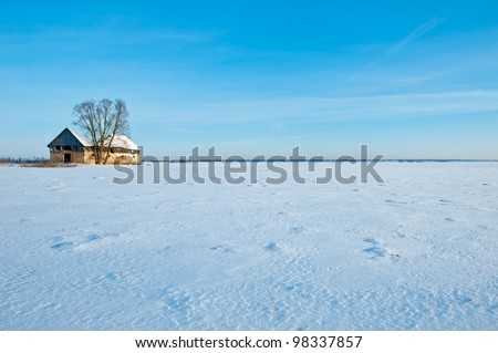 Old shed in the snowy field
