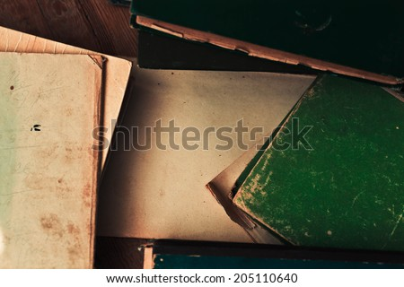 Old sheet of paper and books.Backgrounds - stock photo