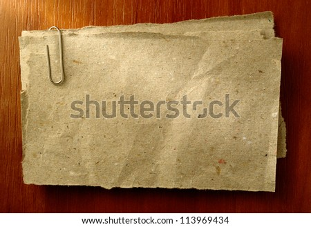 old sheet of paper for notes and clip - stock photo