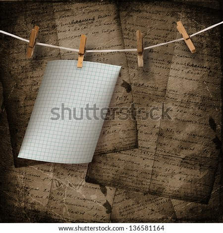 Old sheets hanging on a rope and clothespins on the brown abstract background - stock photo