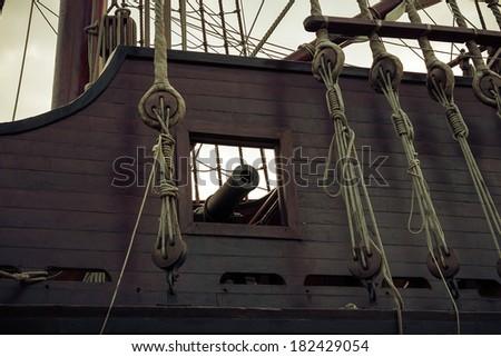 Old ship, gun in sailboat. Vintage retro style. - stock photo