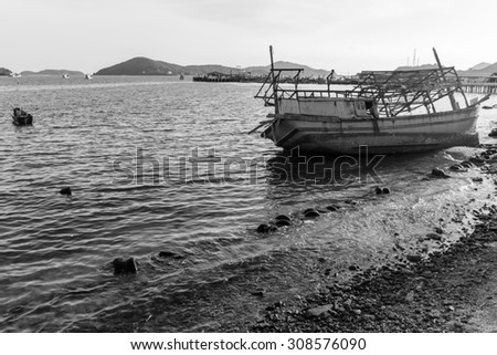 old ship wreck on the shore vintage style