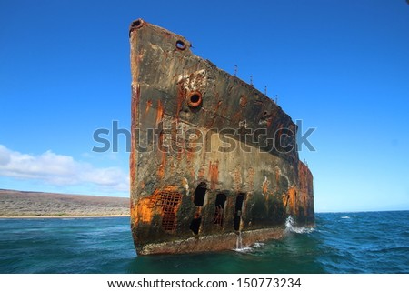Old ship wrecked on the shallow reef off the island of Lanai - stock photo