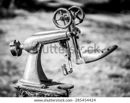 Old shoemaker's tool - stock photo