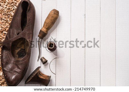Old shoes and recovery tools. Background - stock photo