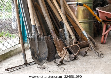 old shovels rakes Tool for working in the garden - stock photo