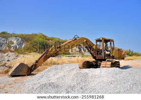 Old Shovels yellow - stock photo