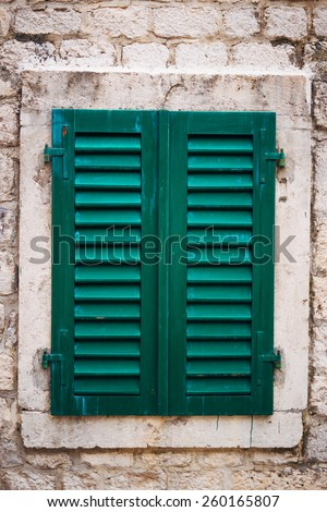 Old shutters on the windows in the old town of Kotor in Montenegro