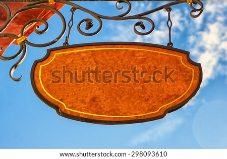 old sign, forge iron, wrought iron, with empty space - stock photo