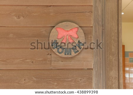 old Sign of public toilet for  lady  brown background - stock photo