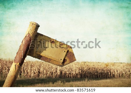 Old signpost - stock photo