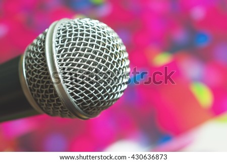 Old silver microphone in concert hall with defocused bokeh lights on background