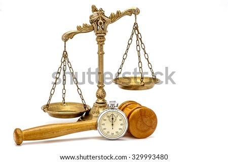 Old silver stopwatch, wooden gavel and decorative scales of justice on the white background, focus on the gavel and stopwatch