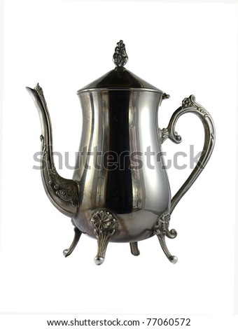 Old silver teapot isolated over white background