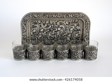 Old silver wine-glasses with a tray  - stock photo