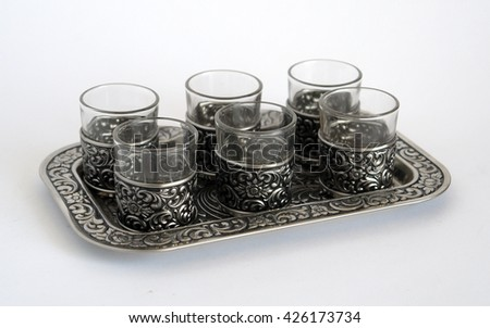 Old silver wine-glasses with pattern on a tray diagonal foreshortening                                - stock photo