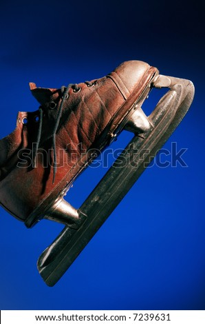 Old skate on a dark blue background - stock photo