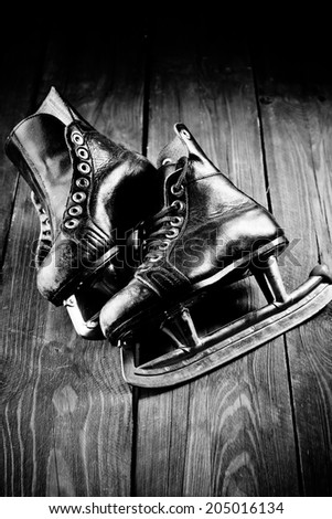 Old skates. Black and white photography - stock photo