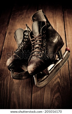 Old skates. Retouching in vintage style. - stock photo