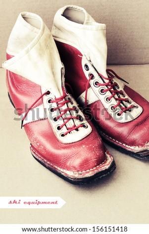 Old ski equipment / Ski shoes  in vintage style / Old Soviet ski boots - stock photo