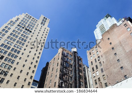 Old skyscrapers in New York with deep blue sky - stock photo