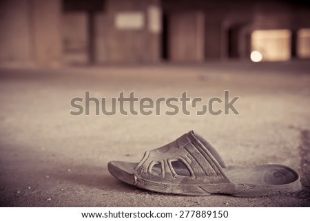 old slippers or shoe in an abandoned building. - stock photo