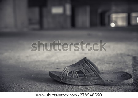 old slippers or shoe in an abandoned building - stock photo