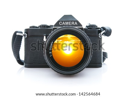 Old SLR Black Camera on White Background - stock photo