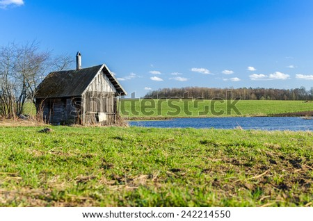Old small abandoned and ruinous house