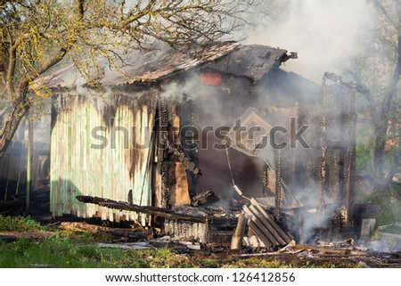 Old small building in full flaming