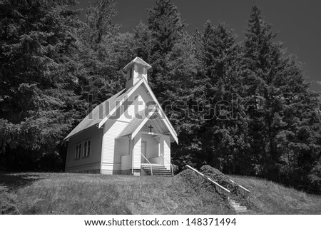 Old small rural church with steeple in Oregon